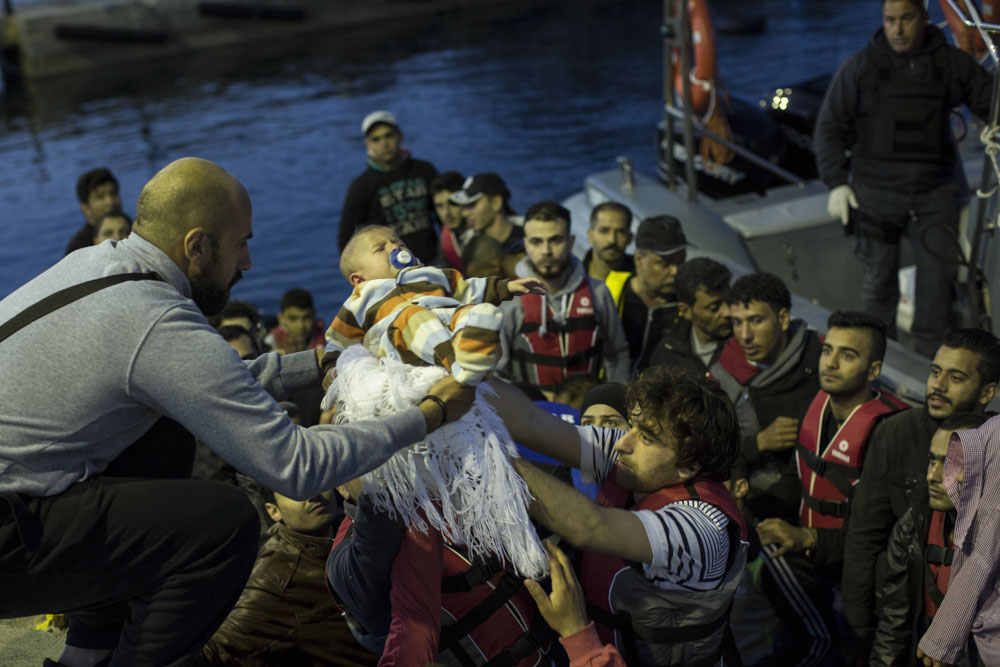 Syria was the most common country of origin. These Syrian parents, travelling with their 4 month-old baby, where rescued at sea by the Greek coast-guards.  Kos port, Greece. May 26, 2015.