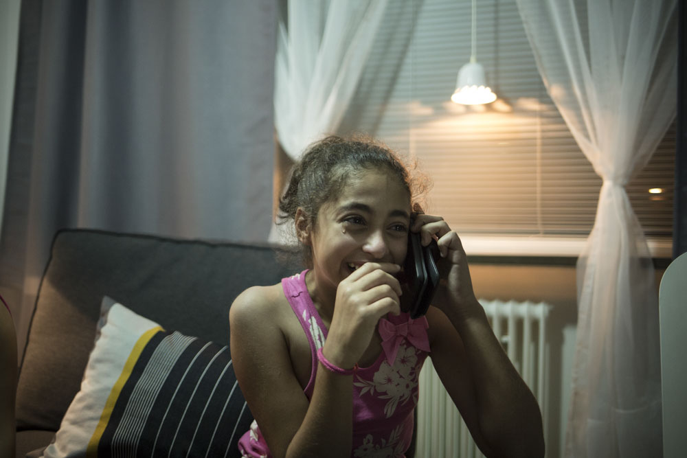 Cidra, Ahmad's niece, is calling her mother who stayed in Syria. Bromölla, Sweden. July 19, 2015.