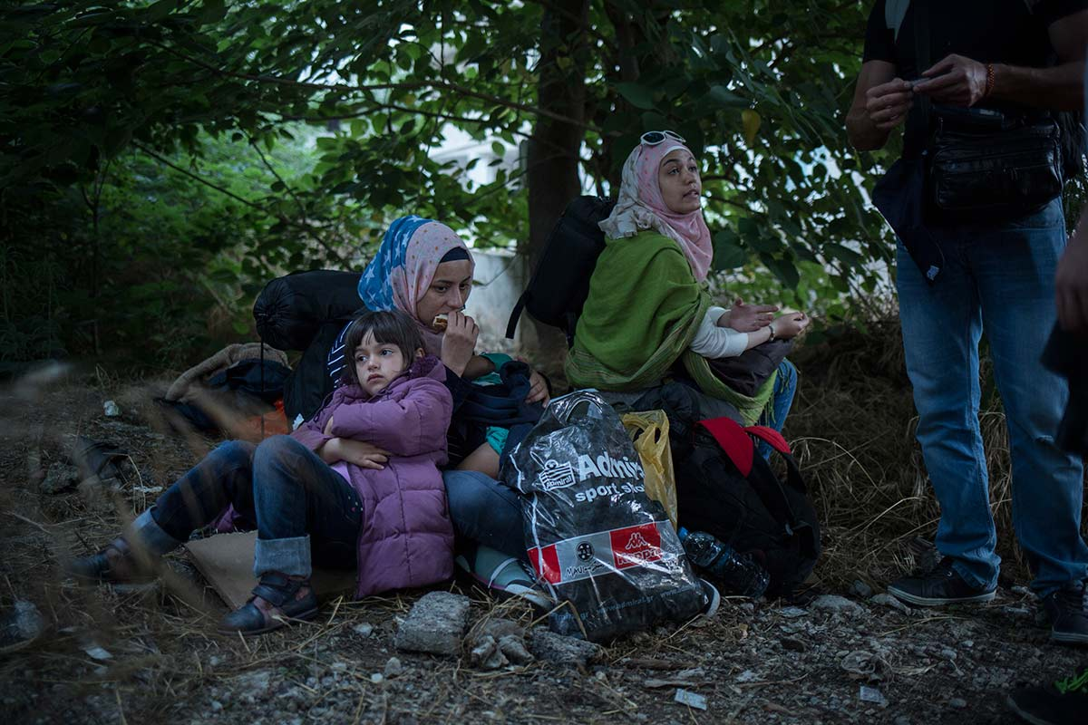 Thessaloniki, July 5, 2015. The family is waiting for a smuggler's driver to take them to the border area where they are not allowed to go to.