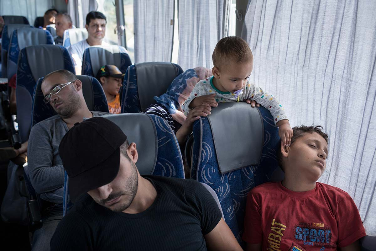 Near Skopje, July 6, 2015. Ahmad's group chose to travel to Skopje, the Macedonian capital, by bus, because the 3 daily trains are not enough for the number of migrants.