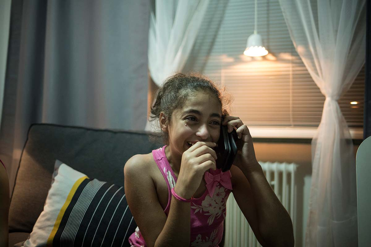 Brömolla, July 21, 2015. Cidra, 11, Ahmad's niece, calls her mother in syria to tell her she reached her destination safely.