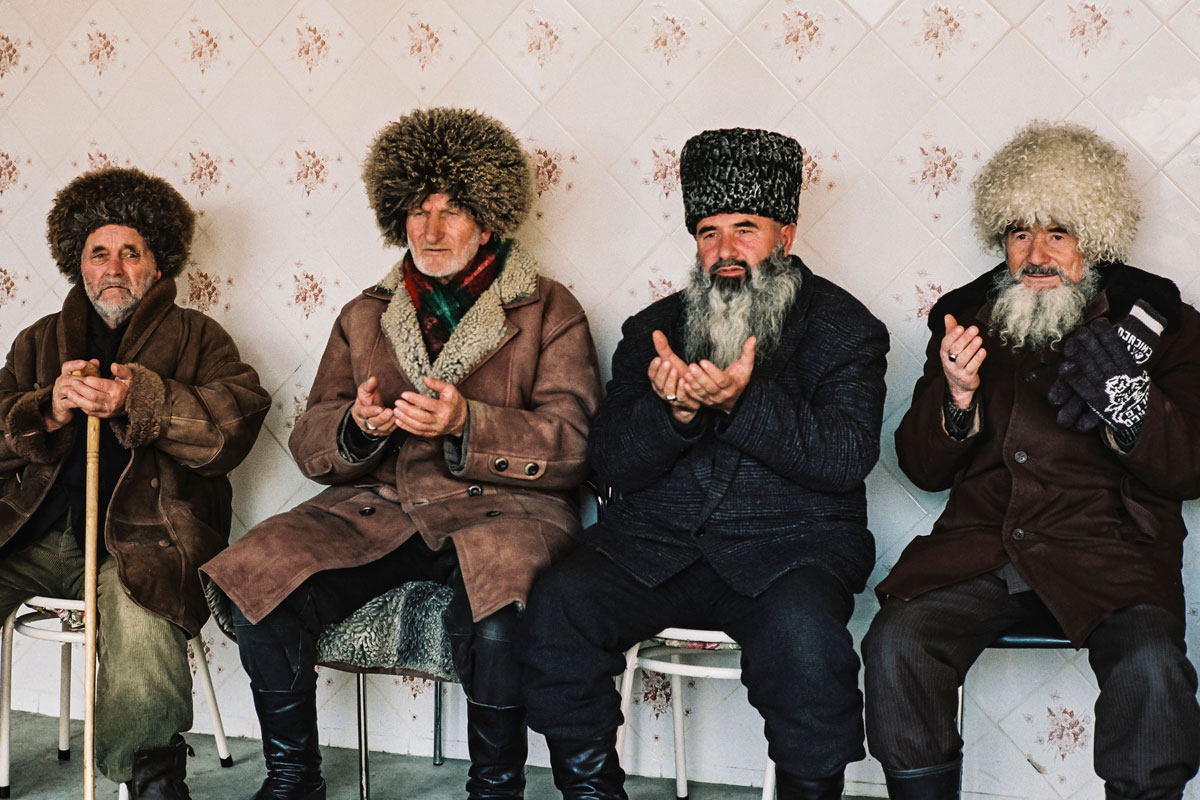 December 14th 1999.  Funeral of the brother of Commandant Sayed, killed in action in the Shali region a few days earlier. The elders of the village, including the father of Shamil Basayev (far right), receive the people's condolences.