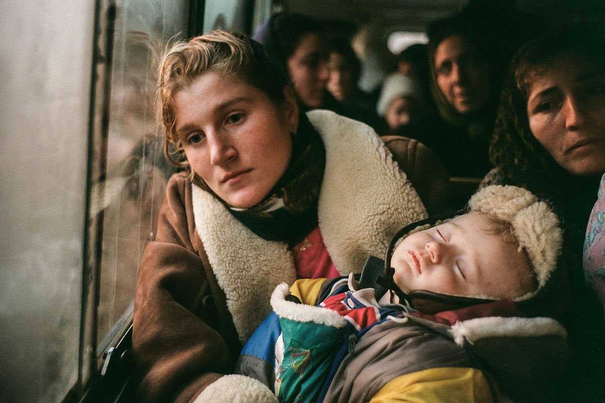 December 26th 1999.  A Chechen woman and her child in a bus headed for Dagestan.