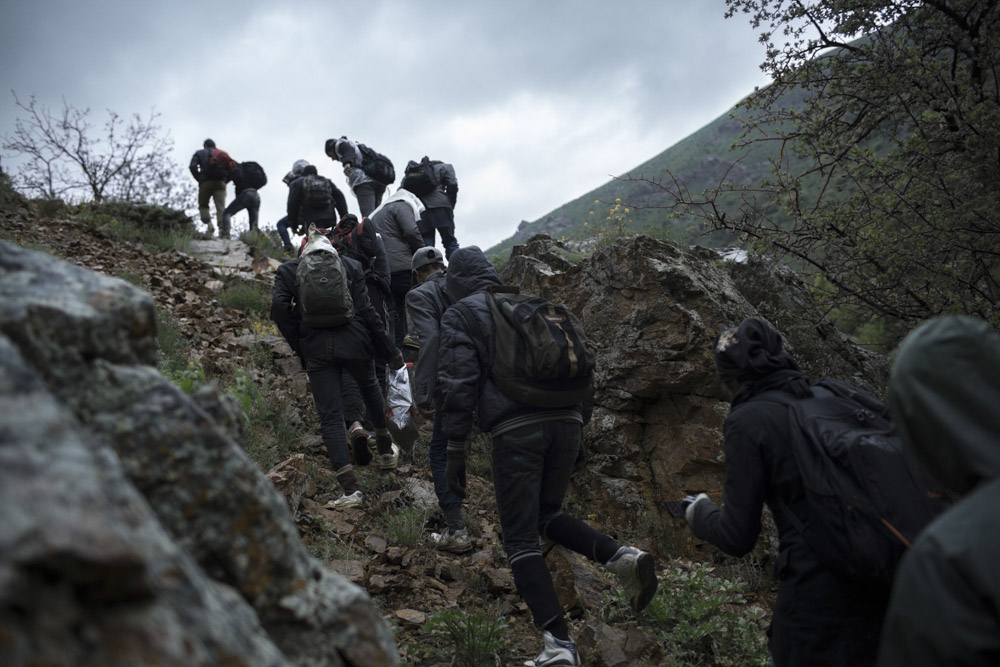 Two smugglers are guiding the travellers through the Kurdish mountains, between Iran and Turkey. May 17, 2013.